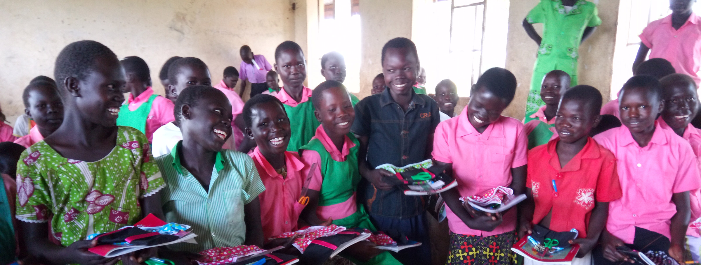South Sudanese refugee girls reciening their reusable menstrural pads