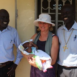 Bishopp Joseph - Edward Mika at the clinic with myself and Lilian the first baby born there