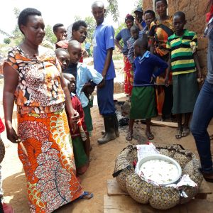 Julienne Niyoyankunze prepares rice with her new Wonderbag. She says that by cooking with it she spends only half of the amount of firewood than before.