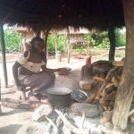 Apai's mother cooking food using firewood