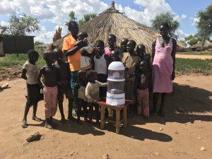 Arch deacon William Nyoma Bidi Bidi with the new water filter given