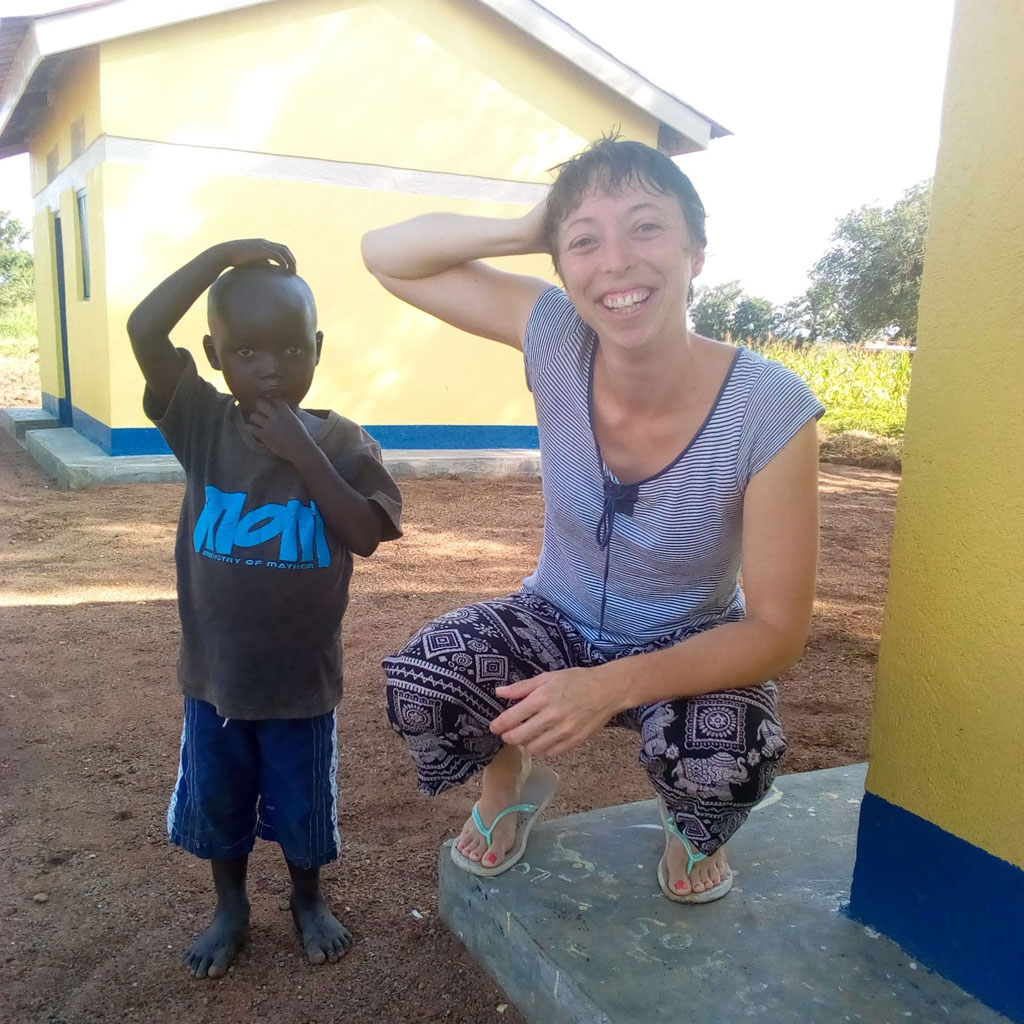 Melanie-relaxing-at-the-beautiful-clinic-staff-compound-with-a-little-child
