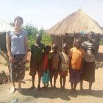 Melanie with Cicila Prosy's 3 children and 2 of the orphans who live with them