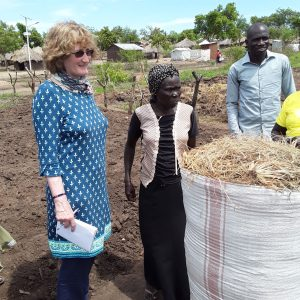 With Julious and Jeska Kiden who is group leader of Emmanuel group based in Imvepi refugee camp. The photo shows the demonstration of sack gardens and the land prepared for vegetable beds behind us.