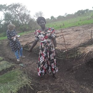 With Yango Yunia in the garden of Joyful group based in Mijale village near the South Sudan border. The photo shows their very healthy seedlings under shade and beds well prepared with green mulch ready for transplanting.