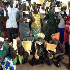 Hoes and gumboots gratefully received by the new excited groups in Mijale