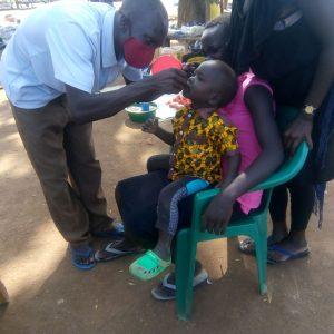 A child receiving Vitamin A