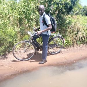 Lulu on his bicycle used for shorter fieldwork trips