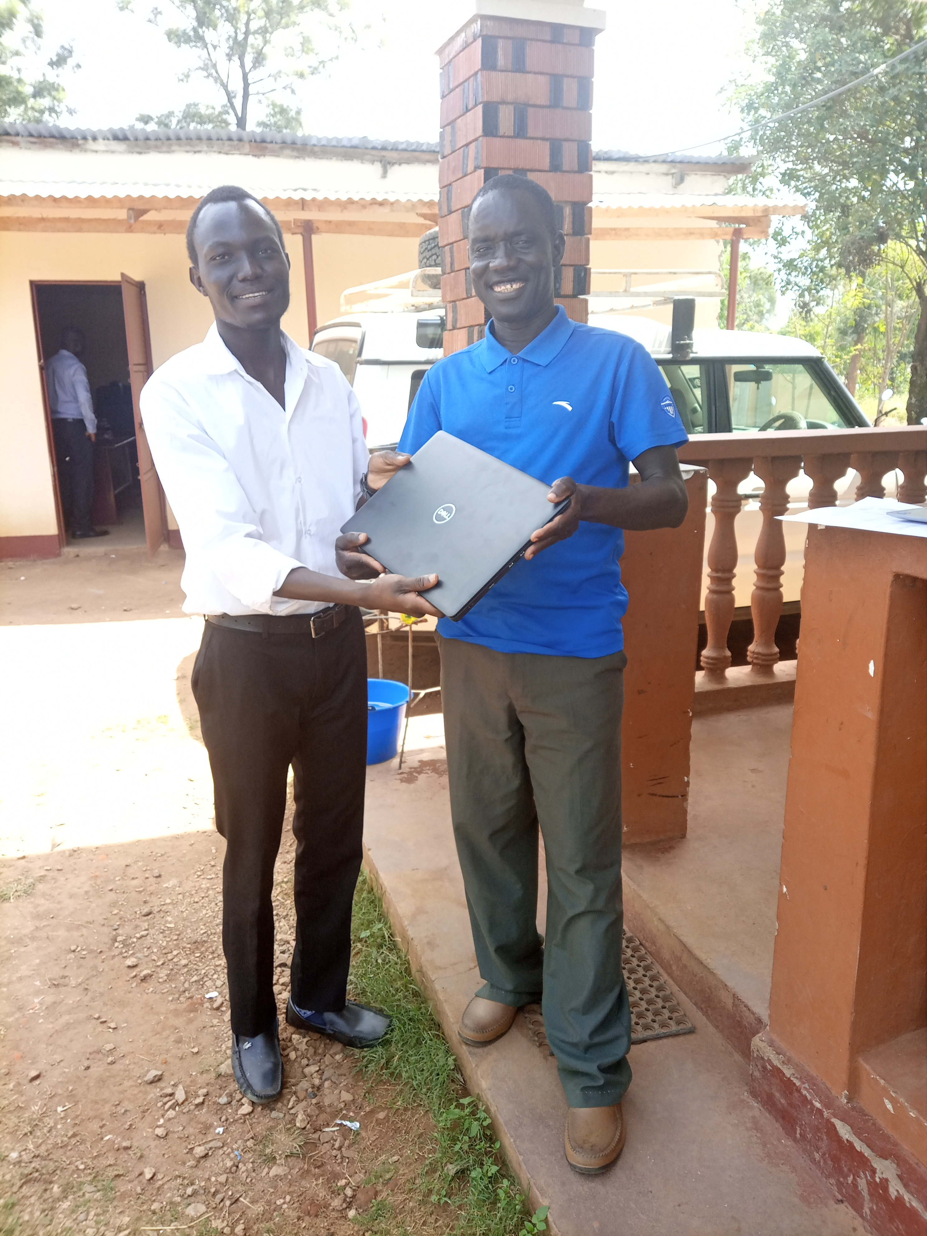 Joel Receiving the new laptop for Jesus film ministry