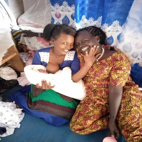 Midwife Bethy and a mum who delivered