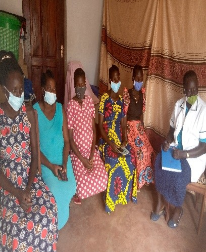Bethy with expected mothers at the antenatal clinic