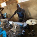 Rev. Joel trying his drumming skills