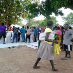 Zone II members receiving their rice while the local leaders monitoring the distribution
